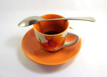 Orange kopp med kaffe Arkivfoto