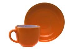 Orange kopp och saucer Royaltyfri Fotografi