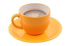 Orange kopp och saucer Arkivbild