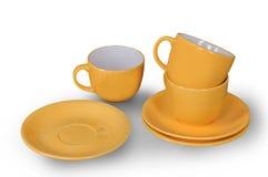 Orange kopp och saucer Royaltyfri Foto