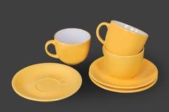 Orange kopp och saucer Royaltyfri Bild