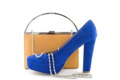 Orange koppling och blåa höga häl Royaltyfria Foton