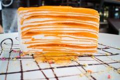 Orange Krepp-Kuchen Stockfotografie
