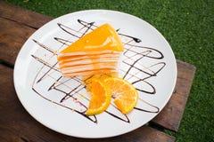 Orange Krepp-Kuchen Stockfotos