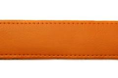 Orange läderbälte på vit bakgrund Fotografering för Bildbyråer