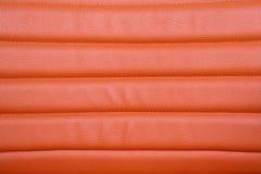 Orange läderbakgrund Fotografering för Bildbyråer