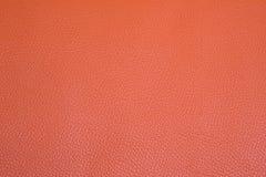 Orange läderbakgrund Arkivbild