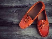 Orange läderskor Fotografering för Bildbyråer
