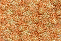 Orange lace on white background. No any trademark or restrict matter in this photo.  Stock Photos