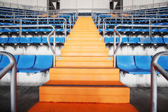 Orange ladder and grandstand at large football stadium. Royalty Free Stock Image