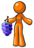 Orange Lady Holding Large Bunch of Grapes Stock Photography