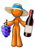 Orange Lady with Vintage Wine Grapes and Hat. Orange lady holding a large bottle of vintage wine with a blank label. She also has a large bunch of grapes and is Royalty Free Stock Photos