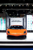 Orange Lamborghini Galardo sports car on display Stock Photo