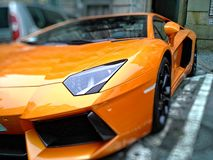 Orange Lamborghini Gallardo on Park Royalty Free Stock Image