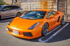 Orange Lamborghini Gallardo on the street of Nikko. NIKKO, JAPAN - NOVEMBER 13, 2016: Orange Lamborghini Gallardo on the street of Nikko town, Japan. Nikko is a Stock Photos