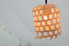 Orange Lamp in Bamboo rattan baskets Royalty Free Stock Photo