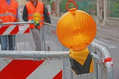 Orange lamp in a roadworks in the city. Big Orange lamp in a roadworks in the city Royalty Free Stock Photography