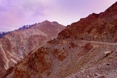 Orange landscape and hill road in Ladakh Stock Photo