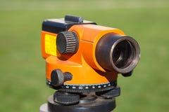 Orange Landsurveyor utrustning Royaltyfria Bilder
