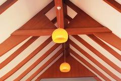 Orange Lantern hanging with wood. Royalty Free Stock Photo
