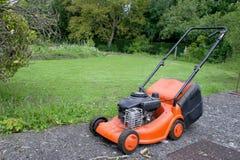 Orange lawn mower Stock Photo