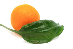 Orange with leaf. Ripe orange with leaf isolated in white Royalty Free Stock Images