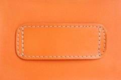 Orange leather. Natural orange leather background closeup Stock Photos