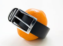 Orange in a leather belt Royalty Free Stock Image