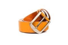 Orange leather belt on white background Royalty Free Stock Images