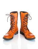 Orange leather boots Stock Photos