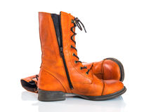 Orange leather boots on white background Royalty Free Stock Photo
