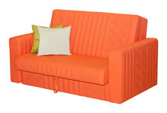 Orange leather sofa with pilllows isolated Royalty Free Stock Photos