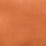 Orange leather texture closeup Stock Photos