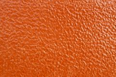 Orange leatherette texture Stock Images
