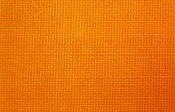 Orange lederner Oberflächenhintergrund lizenzfreie stockbilder