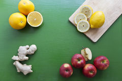 Orange, lemon, apple and ginger. For preparing of fresh juice Stock Photos