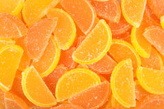 Orange and lemon candy slices as background Stock Images