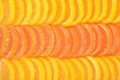 Orange and lemon candy slices as background Stock Photo