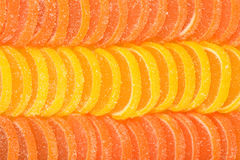 Orange and lemon candy slices as background Stock Image