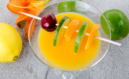 Orange and lemon cocktail on a sand background Royalty Free Stock Photo