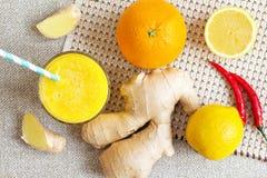Orange, lemon, ginger, chilli  energy smoothies. Stock Image