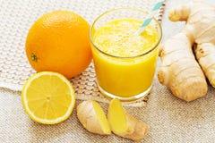 Orange, lemon, ginger energy smoothies. Royalty Free Stock Photos