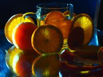 Orange and lemon and juice glass party royalty free stock image