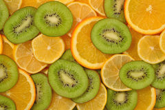 Orange, lemon and kiwi slices background Stock Photography