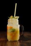 Orange, lemon and lime mix. Fresh cocktail. citrus juice. black background Stock Images