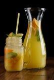 Orange, lemon and lime mix. Fresh cocktail. citrus juice. black background Royalty Free Stock Photos