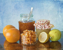 Orange, lemon marmalade and orange peels. Royalty Free Stock Photos