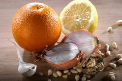 Orange,lemon,onion and pine nuts Royalty Free Stock Image