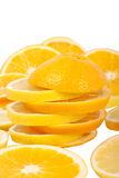 Orange and lemon slices. And some other slices in background isolated over white Royalty Free Stock Photos