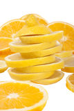 Orange and lemon slices. Lemon slices and some other lemon and orange slices in background isolated over white Royalty Free Stock Photo